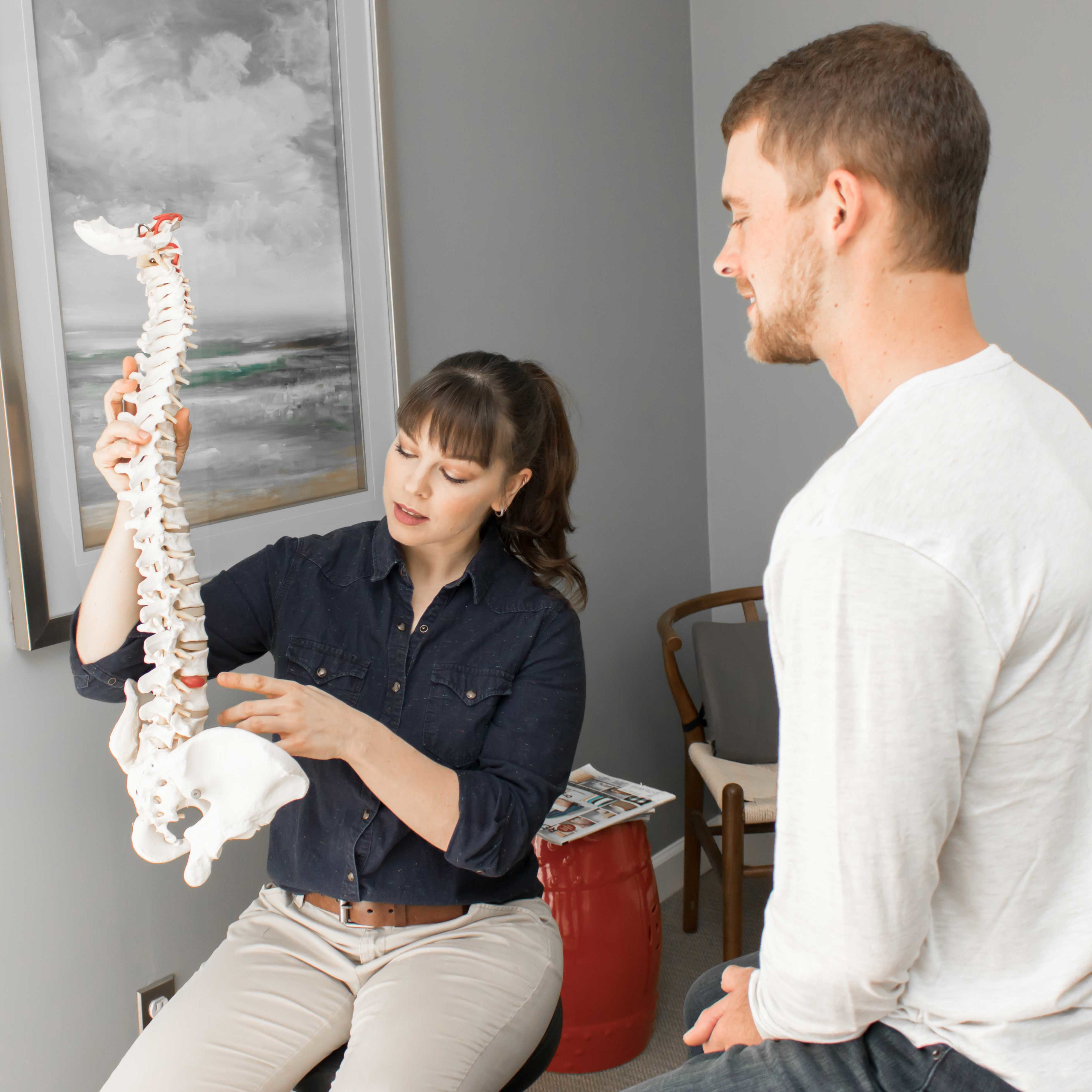 Dr Maggie Chiropractor explaining spinal anatomy to patient
